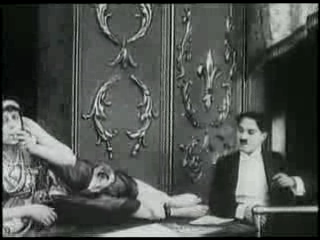 "Charlie Chaplin with The Snake Charmer, one of the many acts in ""A Night at the Shows"""