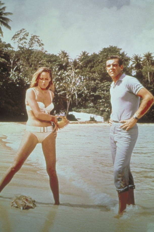 Ursula Andress as Honey Ryder and Sean Connery as 007 plotting their next move in Dr. No.