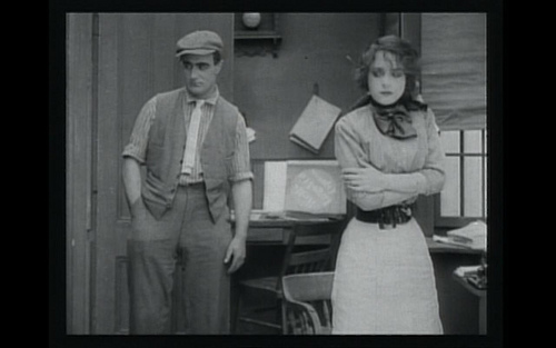 "Dorothy Bernard and Wilfred Lucas share an awkward moment in ""The Girl and Her Trust"""