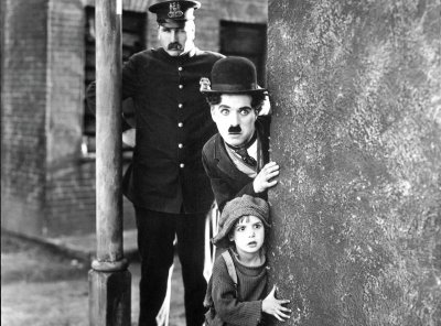 "Charlie Chaplin as The Tramp and Jackie Coogan as The Kid in the 1921 classic, ""The Kid"""