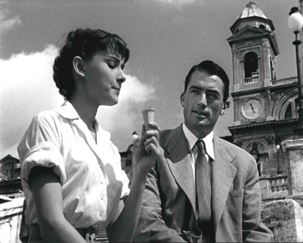 "Hepburn and Gregory Peck chit-chat in ""Roman Holiday"""