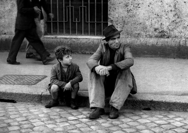 "One of the many iconic scenes from ""The Bicycle Thieves"""