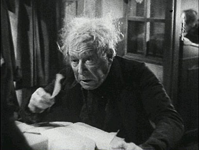 "Seymour Hicks as Ebenezer Scrooge hears something go bump in the night in ""Scrooge"""