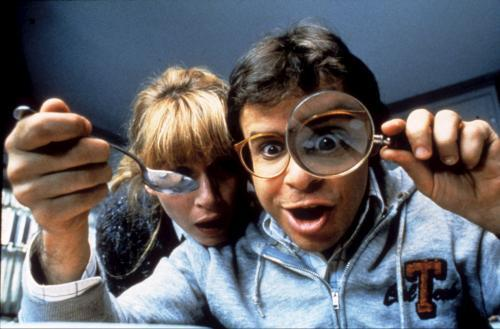 "Rick Moranis demonstrating the standard giant-eye-behind-the-magnifying-glass gag in ""Honey, I Shrunk the Kids"""