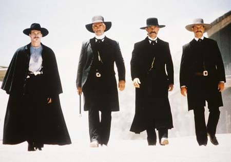 Doc Holliday and the Earp Boys stroll to the O.K. Corral, Reservoir Dogs-style.