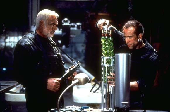 Cage extracts some beads of death while Connery restrains himself from blurting out the obvious dirty comment.